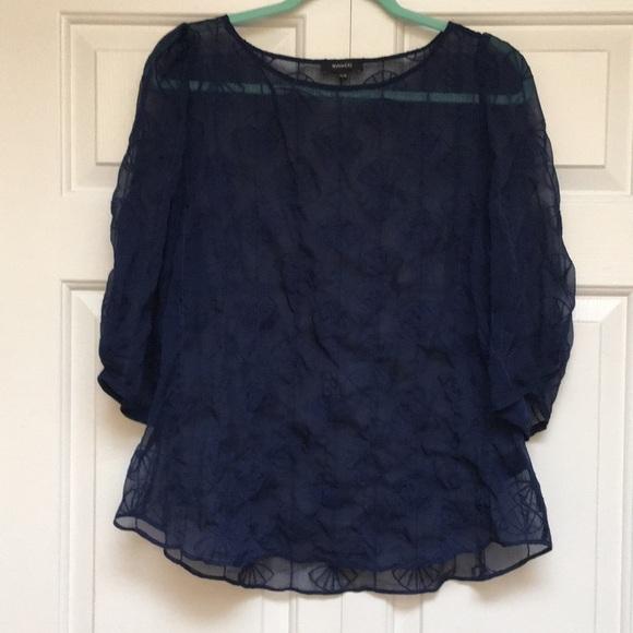Shear blue blouse